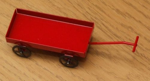 Red dolls house toy cart