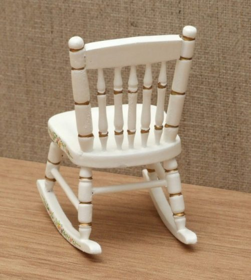 Rear of dolls house nursery rocking chair