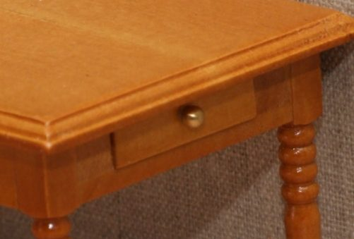 Detail of drawers on dolls house kitchen table